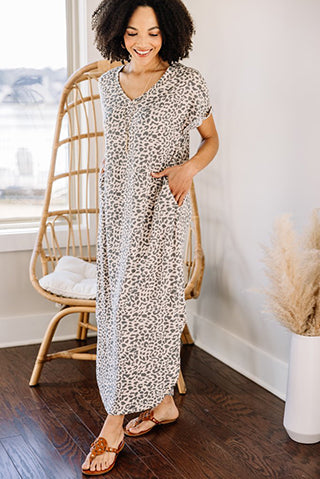 a woman wearing a stay strong blush pink leopard maxi dress