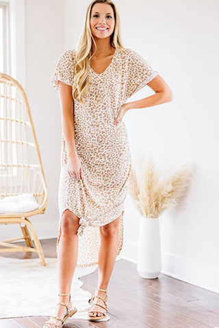 a woman wearing a stay strong ivory white leopard maxi dress