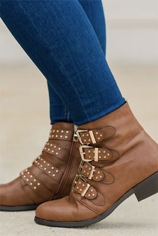 stylish brown boots with buckles