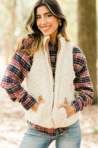 wearing thick off white vest