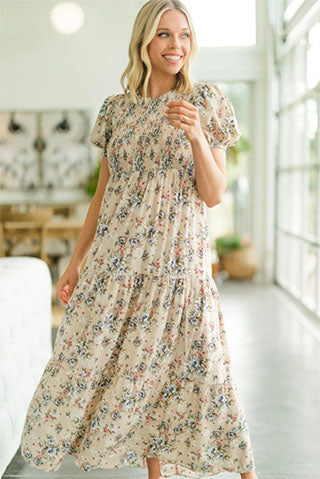 a woman wearing a what a day beige brown ditsy floral maxi dress