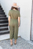 short sleeve jumpsuit, short sleeve green jumpsuit, green jumpsuit, green jumpsuit with polka dots, short sleeve green jumpsuit with white polka dots, jumpsuit with pockets, crop jumpsuit, green polka dot crop jumpsuit with pockets,