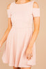 salmon, dress, high rounded neckline, cold shoulder, knee length hem, flare dress, textured pink fabric