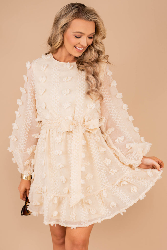dress, long bubble sleeves, ruffled trim, pompom details, round neckline, cream, tied waist, party dress