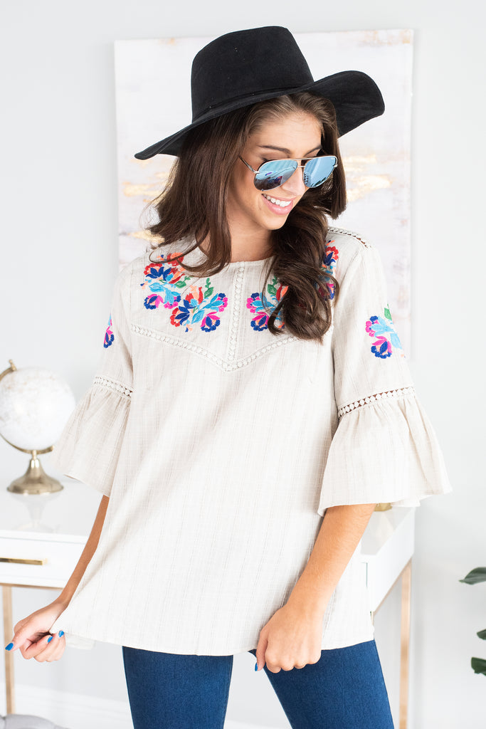 top, short sleeve top, embroidered top, embroidered short sleeve top, floral embroidered short sleeve top, multicolored embroidered top, brown embroidered short sleeve top, brown short sleeve top with multicolored embroidery, blouse, short sleeve blouse, short sleeve embroidered blouse, brown short sleeve embroidered blouse with multicolored embroidery, brown short sleeve blouse with multicolored floral embroidery,