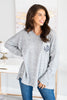 gray sweater, monogram sweater, gray monogram sweater, gray v neck sweater, gray monogram v neck sweater, gray sweater with front pocket, gray sweater with chest pocket, gray monogram v neck sweater with chest pocket, casual top, generous fitting top, long sleeve v neck monogram top,