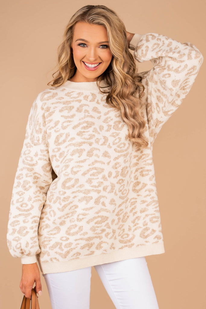 sweater, white leopard sweater, round neckline, leopard print, bubble sleeves, knit fabric, cozy, natural