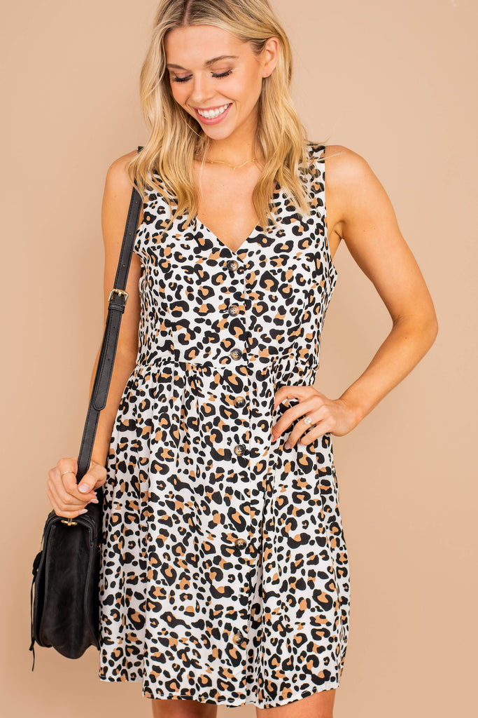 dress, v-neckline, sleeveless, button detailing, defined waist, flattering silhouette, white, flared fit, leopard print