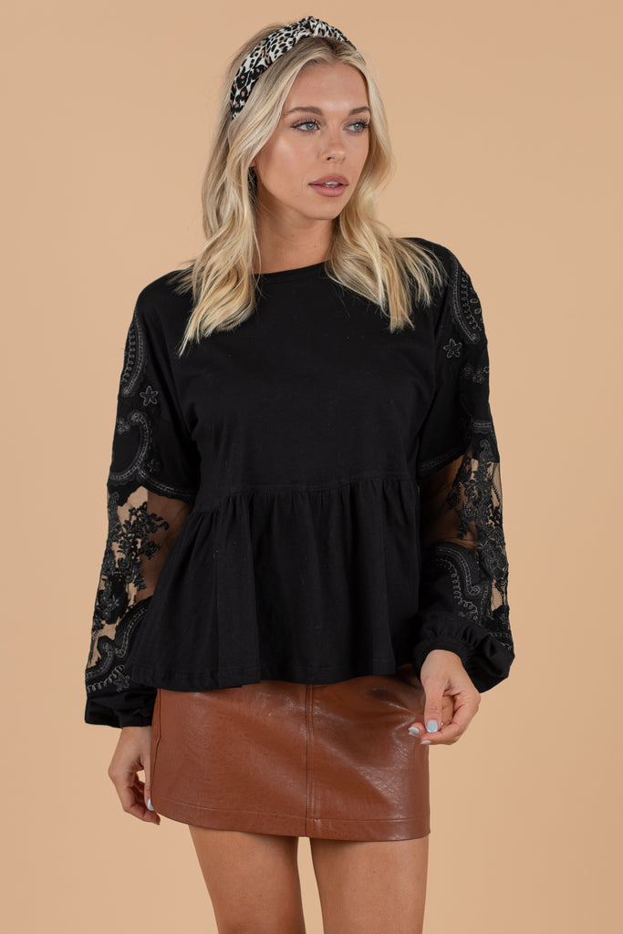 round neckline, long, lace sleeves, and a peplum detail.