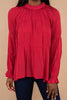 red, top, round neckline, long bloused sleeves, button keyhole back, holiday