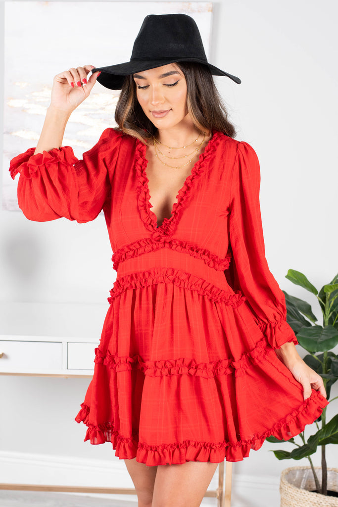 red dress, dress, v-neck, long sleeves, ruffles, tiered design, open back, silhouette