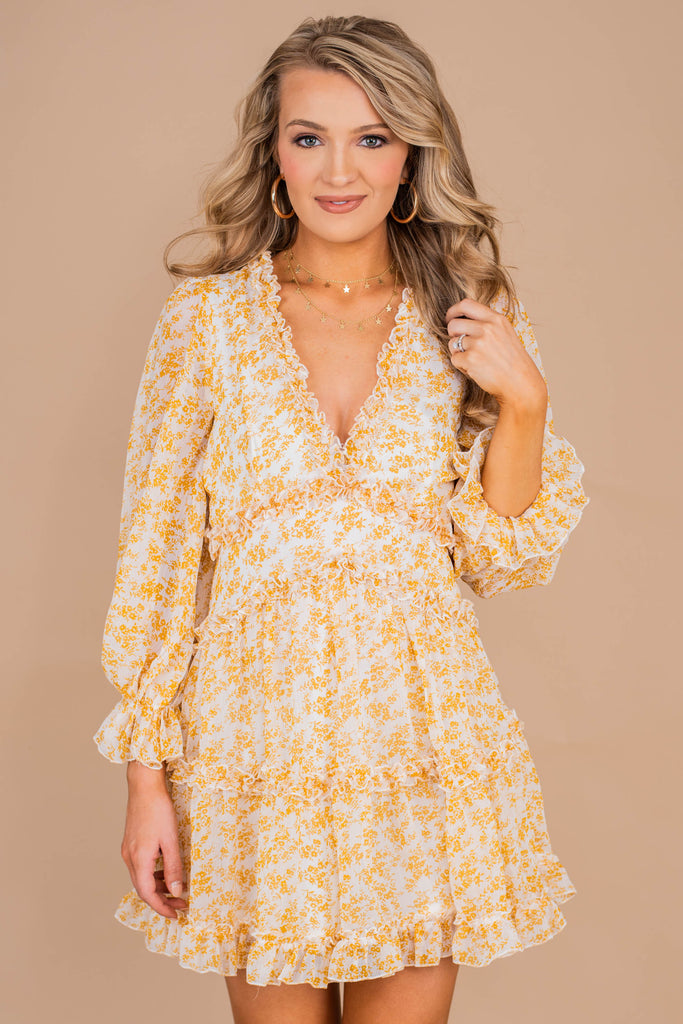 dress, feminine dress, ditsy floral print, ruffles, v-neck, long sleeves, elastic cuffs
