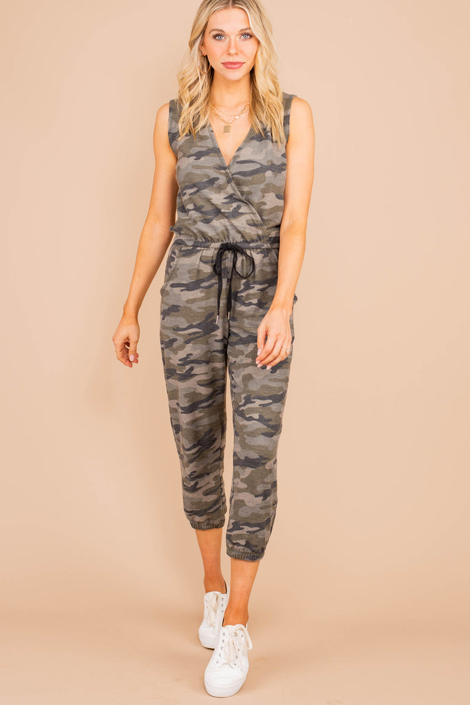 jumpsuit, surplice v-neckline, sleeveless, elastic waist, camo print, green, tied waist, comfy, flattering, casual