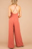 jumpsuit, pink, halter neckline, open strappy back, pockets, wide legs, chic
