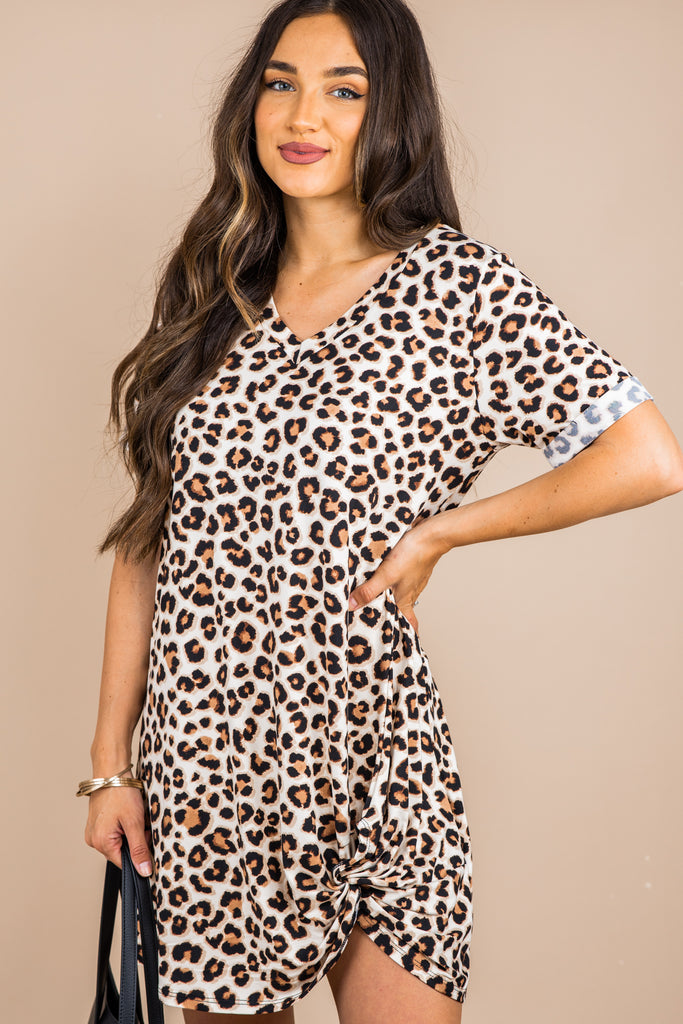 short cuffed sleeves, a v-neck, leopard print, knotted hemline, short sleeve dress, brown dress, neutral dress, leopard dress, leopard print dress, casual dress, short sleeve leopard dress, v neck dress, leopard v neck, pattern dress, short sleeve pattern dress