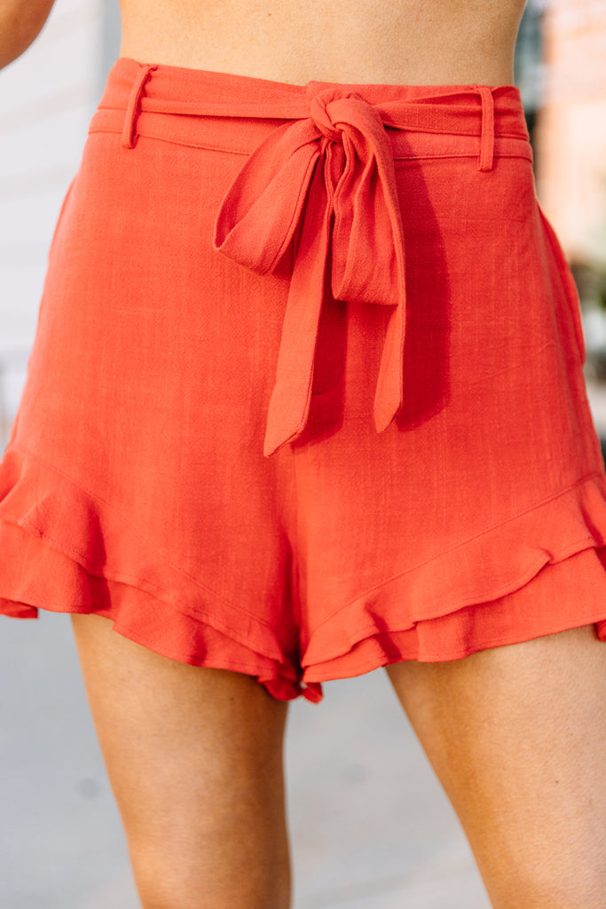 ruffled hemline, tied waist, ruffled shorts, shorts, red