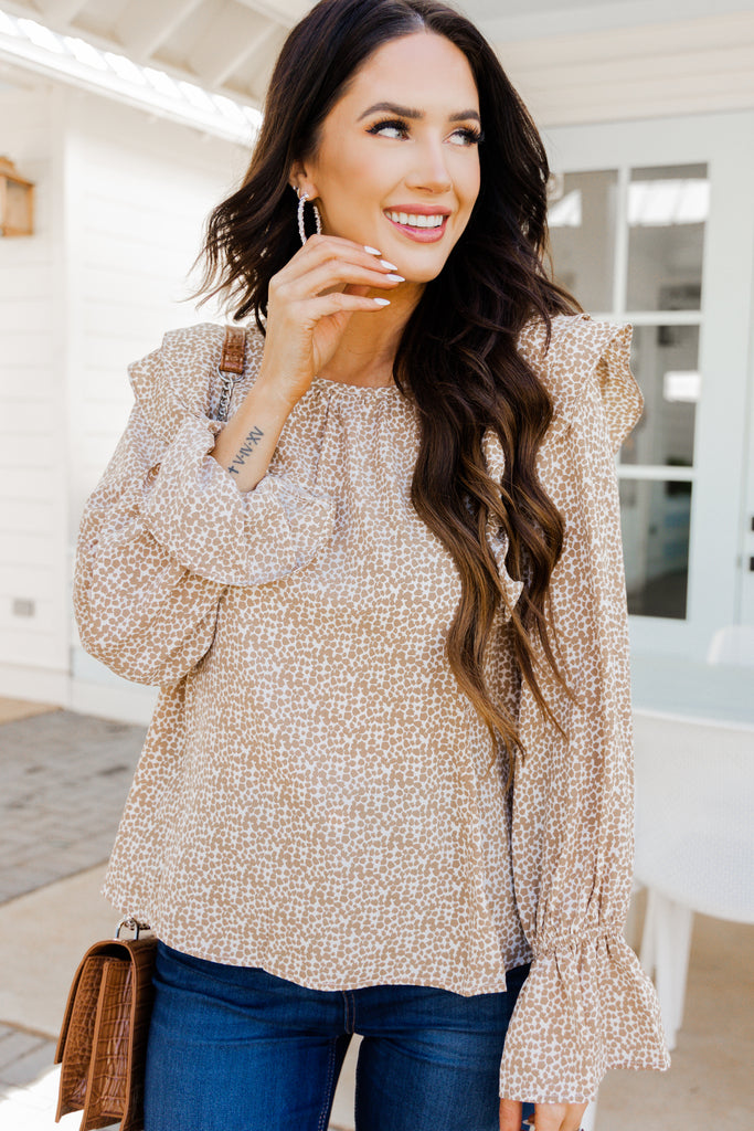 spotted ruffled blouse