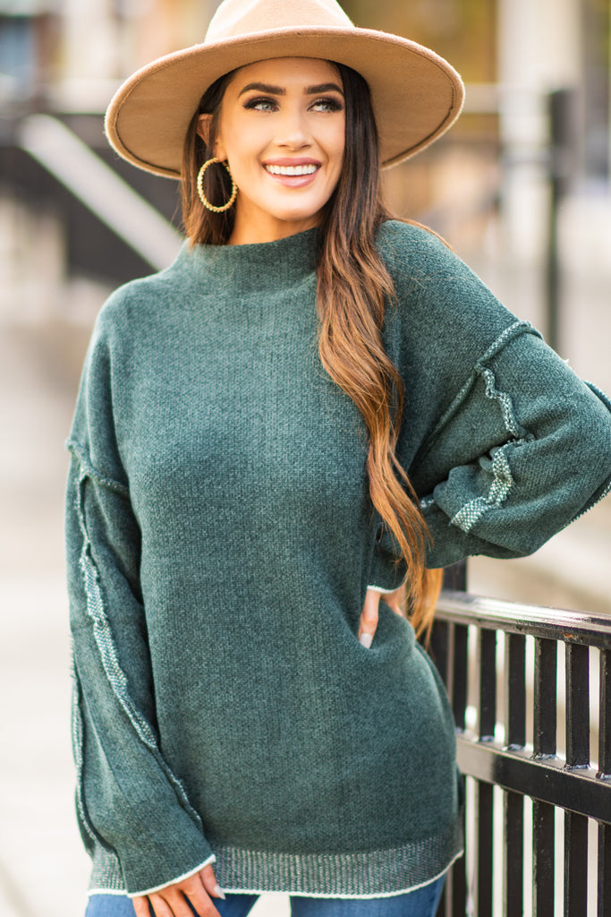 solid sweater with exposed seams