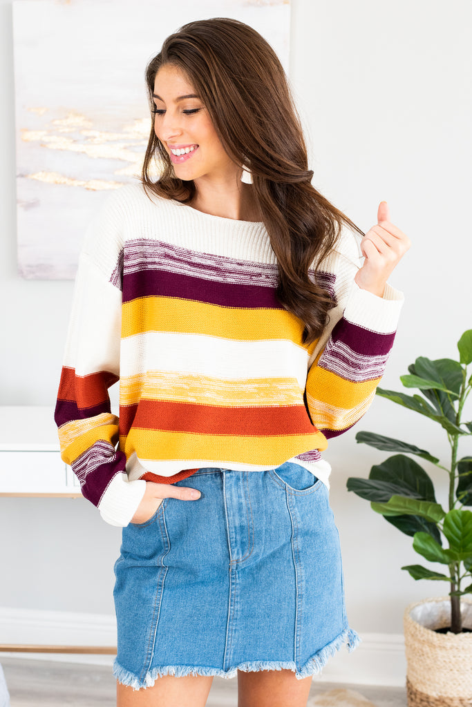 striped sweater, sweater, fall, winter, cozy, warm, wide neckline, long sleeves, knit fabric, white, orange, yellow, plum, purple, cream