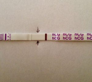 extremely faint line pregnancy test strip