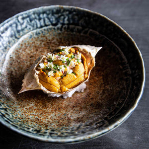 BLUE SWIMMER CRAB SALAD WITH SEA URCHIN MAYONNAISE, UNI GOLD, OSETRA CAVIAR, CHIVES AND GARLIC FLOWERS