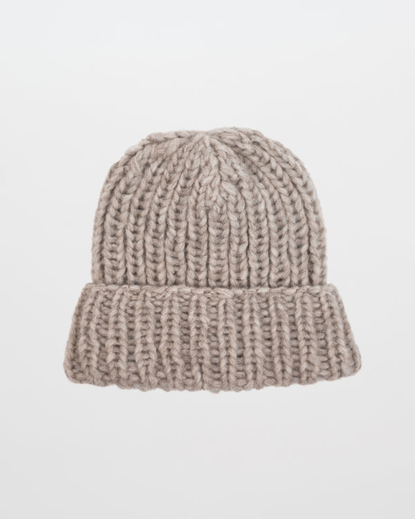 The Hiker's Hat in Beige by Forefolk. Handmade and sustainably sourced wool knit hat. Soft, lightweight, and durable.