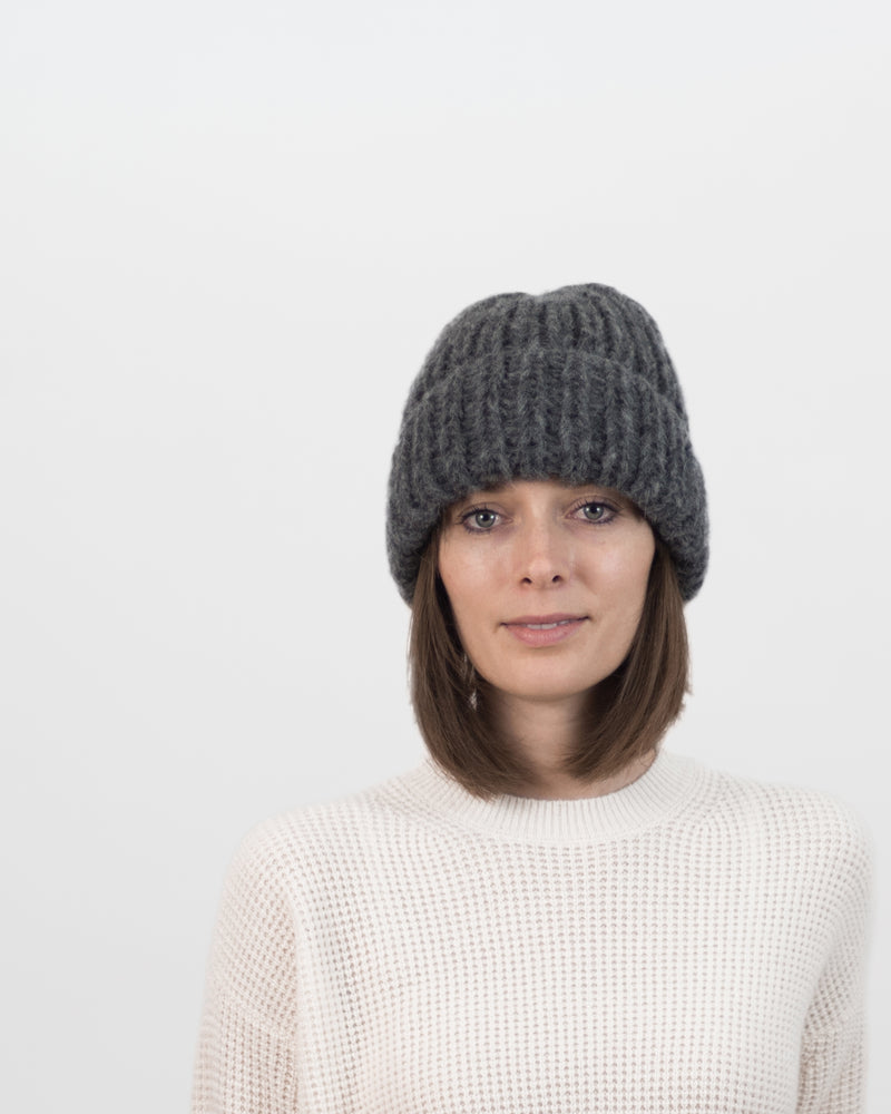 The Hiker's Hat in Grey by Forefolk. Handmade and ethically sourced wool knit hat. Soft, lightweight, and durable.