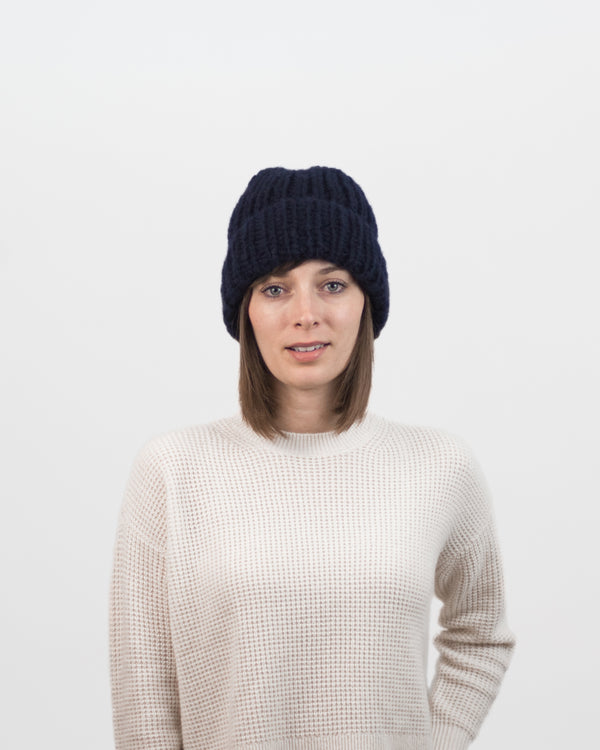 The Hiker's Hat in Navy by Forefolk. Handmade and sustainably sourced wool knit hat. Soft, lightweight, and durable.