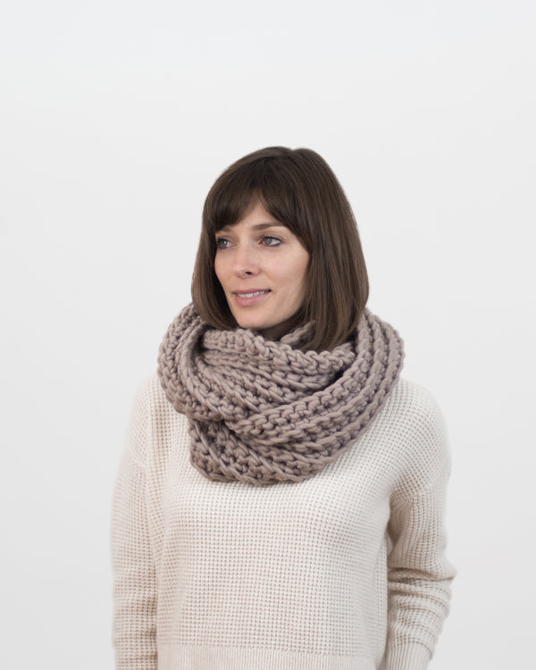 The Vagabond Infinity Scarf in Beige by Forefolk. Handmade and sustainably sourced. Chunky knit wool infinity scarf with a ribbed stitch.