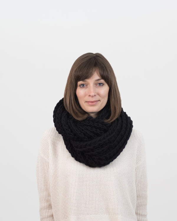 The Vagabond Infinity Scarf in Black by Forefolk. Handmade and sustainably sourced knit wool scarf.