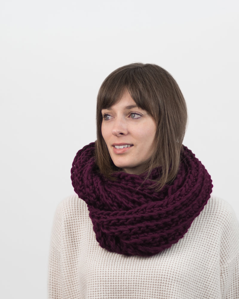 The Vagabond Infinity Scarf in Burgundy by Forefolk. Handmade and sustainably sourced wool knit fall scarf.