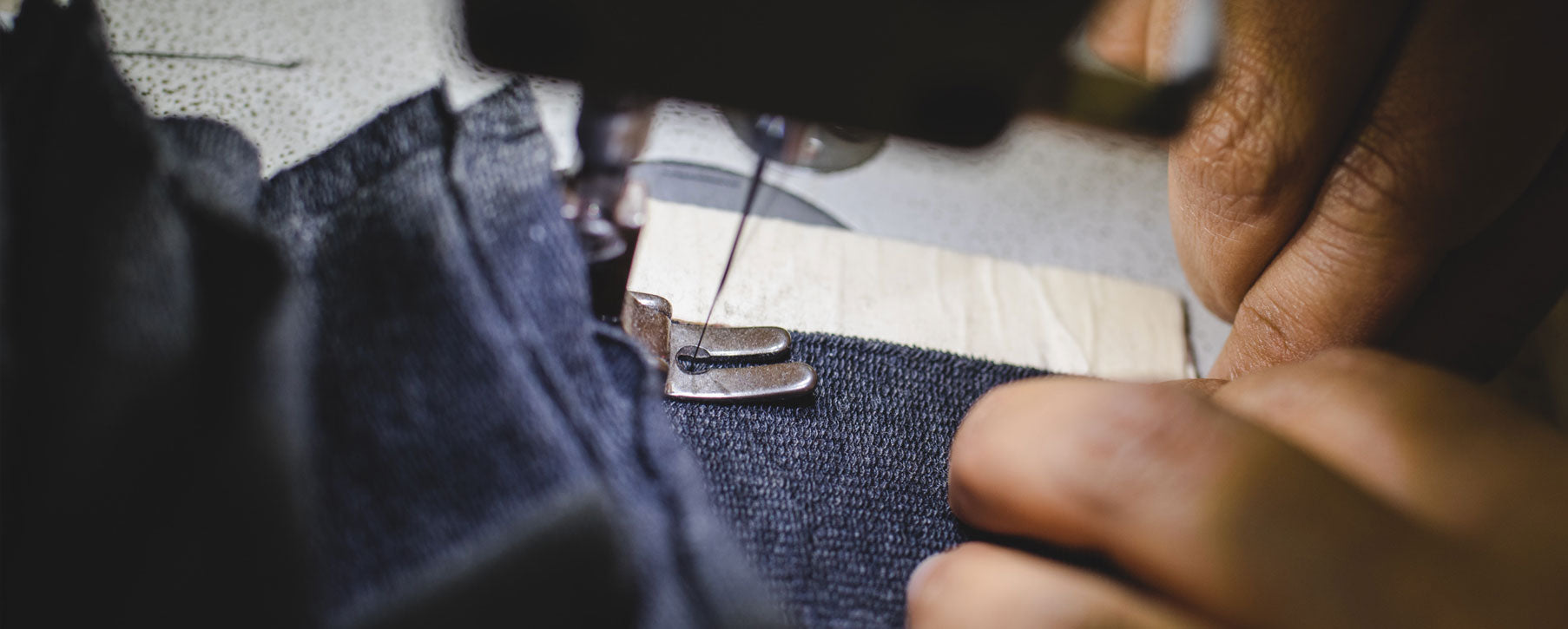 Sewing operator stitching french terry fabric in worker owned cooperative in Peru