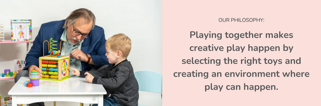 ToyVentive's philosophy, Grandparent playing with child, activity cube at table