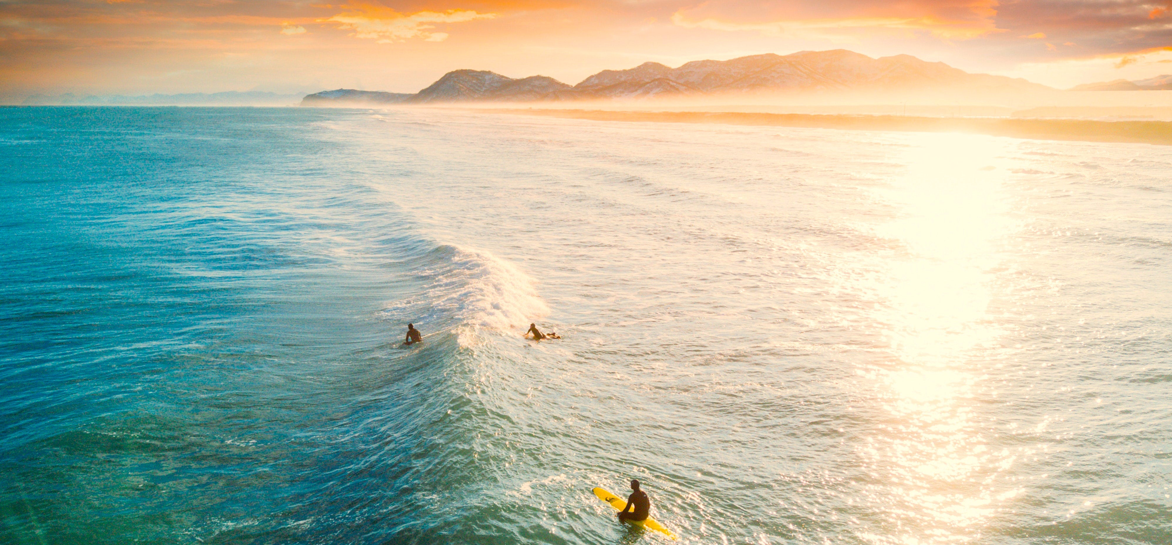Surflogic Australia Team Page Showing Surfers in the Line Up at Sunset