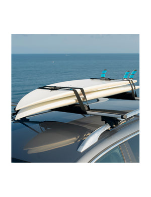 Surflogic Tie Down Surfboard Straps Being Used to Secure Two Surfboards to a Van with Surflogic Aero Roof Racks