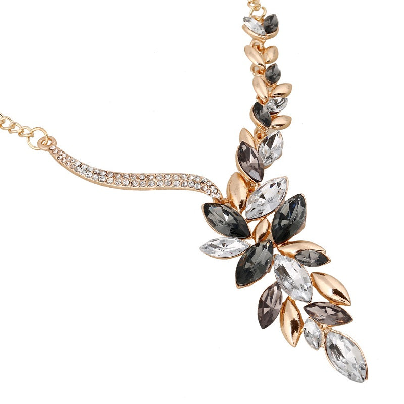 Charming Crystal Necklace/Earring  Set with Flowing Leaf Shapes