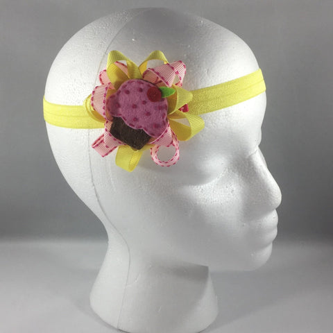 Stitched Headband for a child of 12-18 mos.  Pretty Yellow and Pink Bow is on a hair-clip so it can be worn without the yellow headband.
