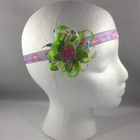 Stitched Headband for a baby age 3 - 6 mos.  Pretty Green Ribbon Bow is on a hair-clip so it can be worn without the headband.