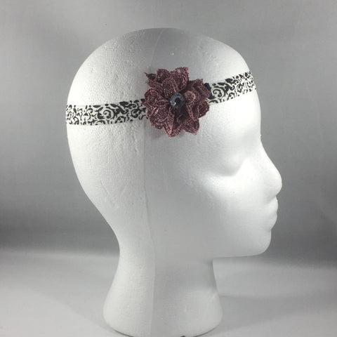 Headband, Size Newborn.  Hand Crocheted Mauve Flower on a black pattern stretch headband.