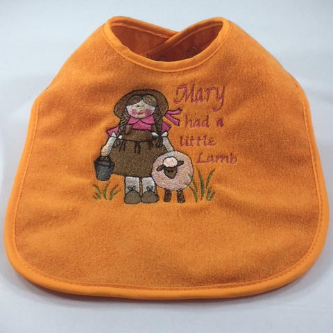 "Embroidered Orange Baby Bib with /embroidered Little Mary and the words, ""Mary had a little Lamb"""