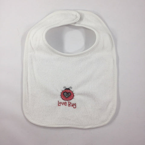 "White Baby Bib Embroidered with a Red Lady Bug and the words ""Love Bug"""