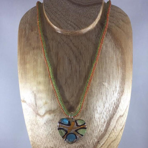 Green and Orange Rope Necklace with Glass Seed Beads and a Lampwork Heart Pendant.  Sterling clasp.  Necklace 18""