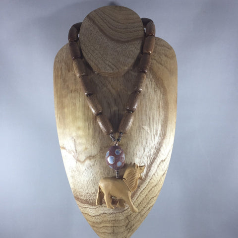 Wooden cylinder beads strung on wire with hand carved lion focal.  Oval flat back stone wit inlay.  Matching earrings included.  Necklace 18""