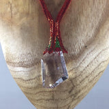 Necklace, Large Swarovski Cosmic Pendent hanging from hand beaded rope.