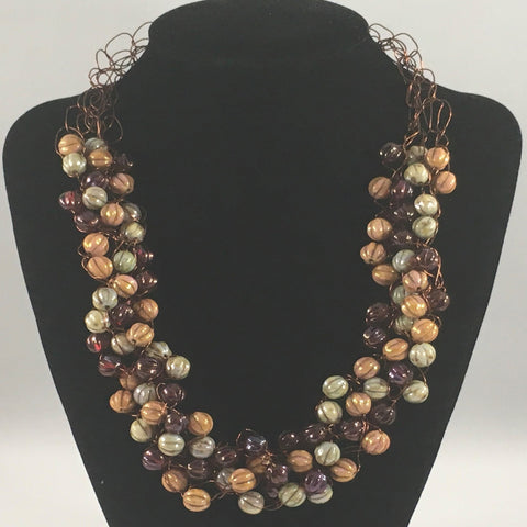 "Crocheted Bead Necklace, Earth tone colored beads.  Necklace measures 20"" around."
