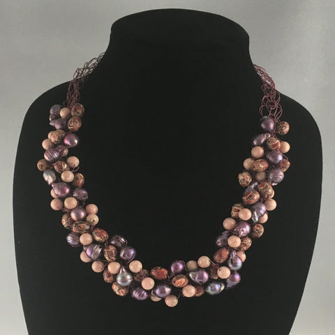 "Hand crocheted wire necklace with shades of mauve and sand colored beads interwoven.  Necklace measures 23"" around."