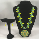 "Green striped and spotted ceramic and yellow duckbill beads with pendant.  Necklace measures 18"" around.  Pendant 2"".  Sterling wire earrings included."