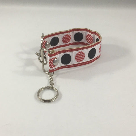 Key fob with black circles and red dotted circles.  Handmade by sisters2creations. Can wrap on wrist or hang on hook.