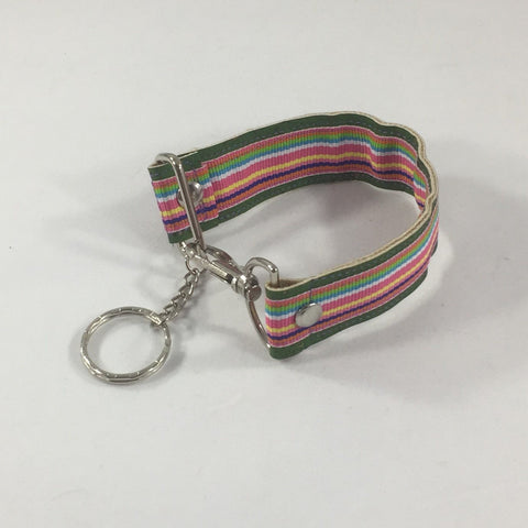Key fob with bright colored thin stripes.  Handmade by sisters2creations. Can wrap on wrist or hang on hook.