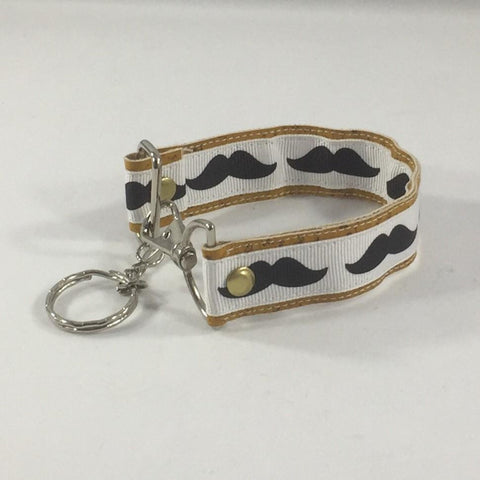 Accessory, Key Fob.  Mustache Print. Handmade by sisters2creations. Can wrap on wrist or hang on hook.